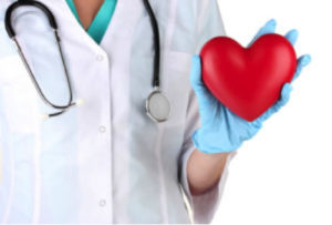 doctor holding a toy heart